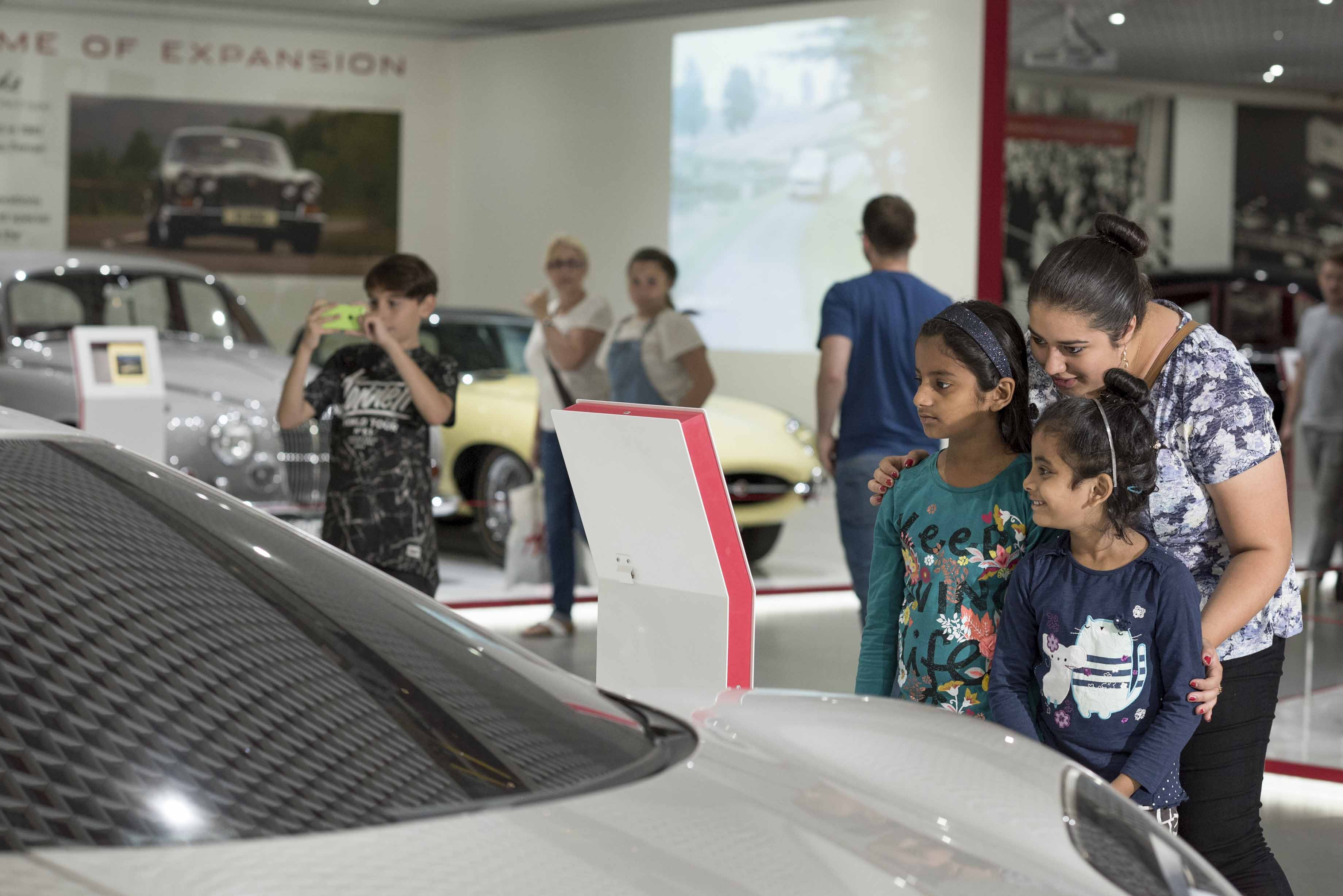 Families looking around the Jaguar gallery