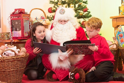 Santa reading to two children