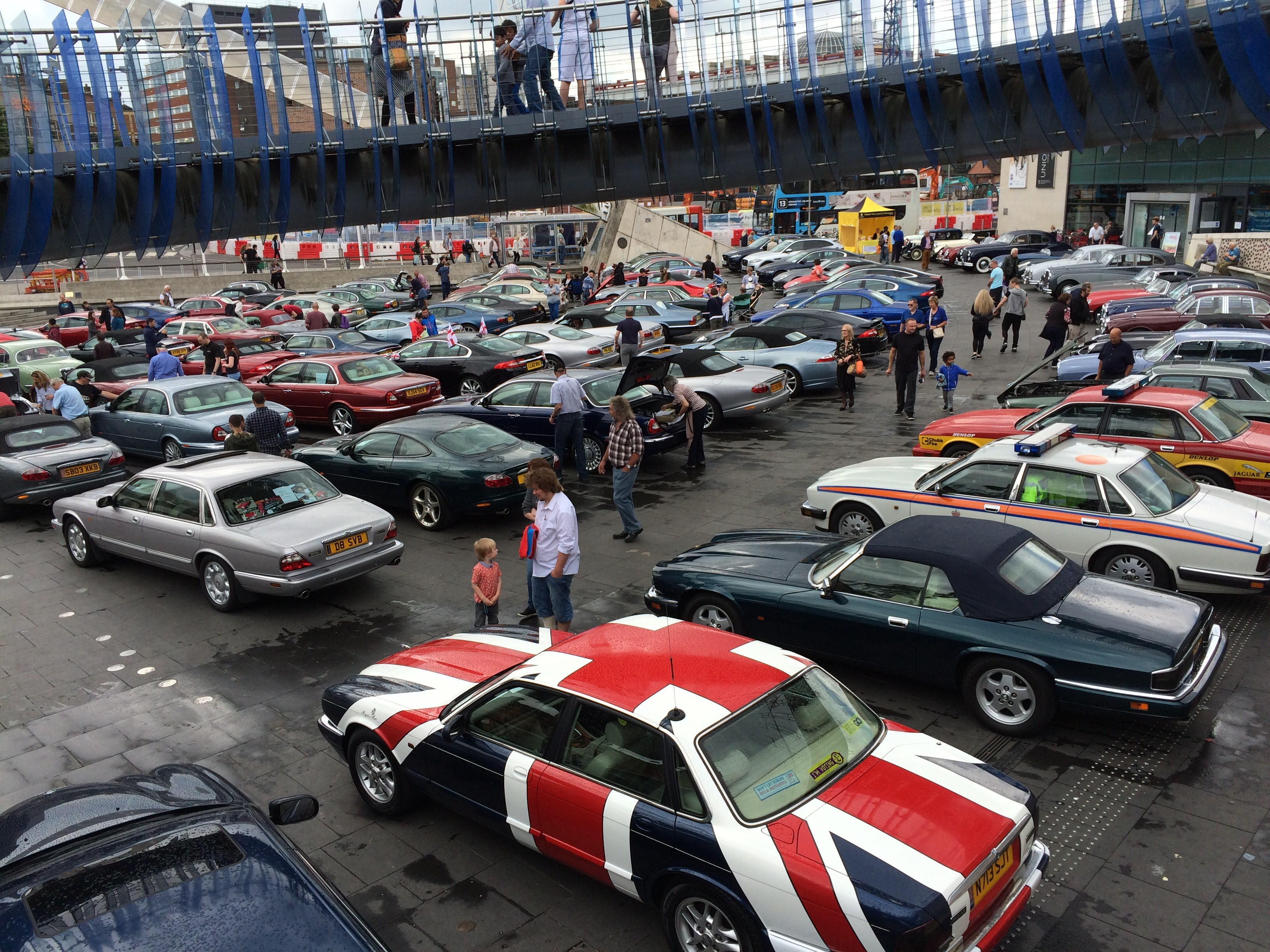 a display of Jaguar cars fills the space outside the Museum