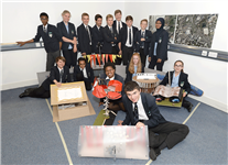 Pupils present miniature pavilions for Millennium Place at Coventry Transport Museum